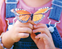 image of girl with butterfly